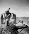 19760203128 | John Deere tractor pulling an early field ditcher | Photograph | Anonyme - Anonymous |  |