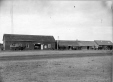 19760211100   The North-West Jobbing & Commission Company freight sheds in Lethbridge   Photograph   Anonyme - Anonymous     