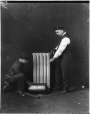 VIEW-8803 | Plumbers repairing hot water radiator, 1909 | Photograph | Wm. Notman & Son |  |